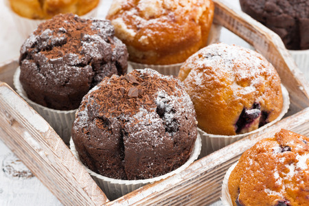 blueberry muffin: delicious muffins on a wooden tray, closeup Stock Photo