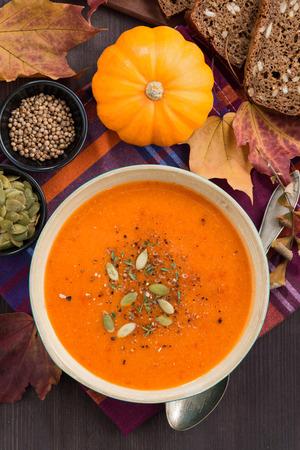 pumpkin soup: pumpkin soup in wooden bowl, top view