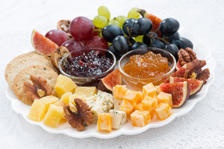 obstteller: cheese and fruit plate, closeup, horizontal