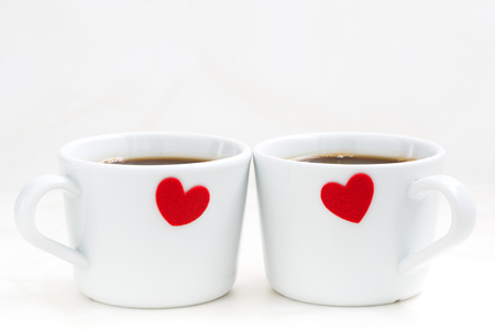 valentin day: White coffee cups with red hearts, closeup, horizontal