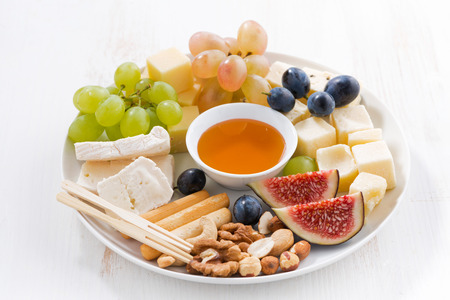 fruit plate: plate of cheese, fruit and snacks, horizontal