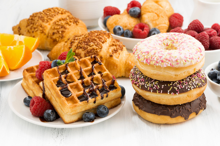 assortment of confectionery and fresh berries, closeup