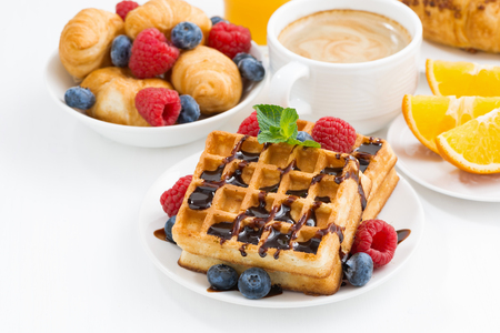 fruits juice: traditional sweet waffles for breakfast on white table, closeup Stock Photo