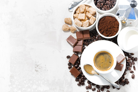 cup of espresso, ingredients and sweets and white background, top view, horizontal Reklamní fotografie