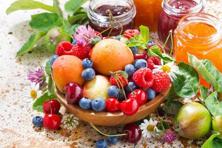 jams: fresh seasonal fruits and berries, jams, closeup top view, horizontal Stock Photo