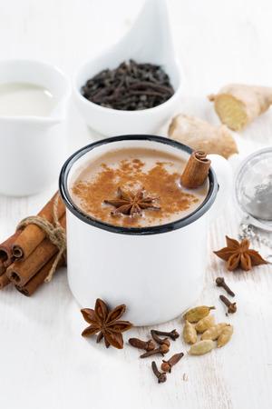 Masala tea and ingredients, closeup vertical, top view