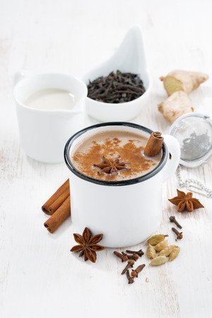 Masala tea and ingredients on white table, vertical Stock Photo