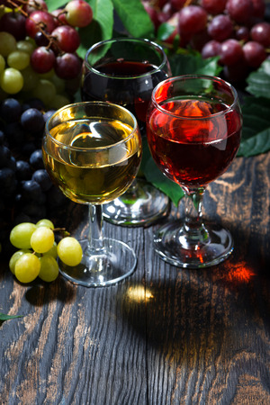 assortment of wine on wooden background, vertical, closeup