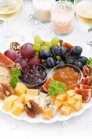 manjar: delicacy cheese and fruit plate to the holiday, vertical, closeup