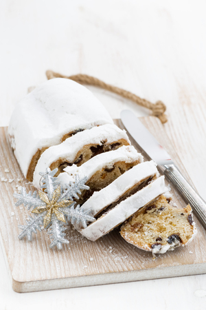 Christmas Stollen on a cutting board, vertical, top view Stock Photo