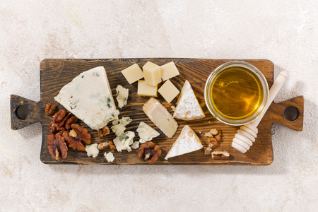tabla de quesos: cheeseboard on a white background, top view, horizontal