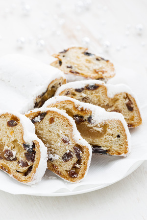 Christmas Stollen on a plate, vertical, closeup, top view Stock Photo