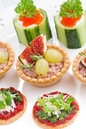 Set of festive Christmas mini appetizers, top view, vertical, closeup Stock Photo