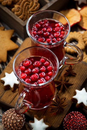 punch spice: Christmas drink hot cranberry tea and cookies, vertical, top view, closeup Stock Photo