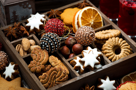 wooden box with Christmas sweets and spices, closeup