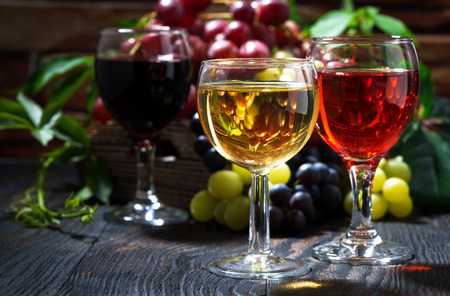 glasses of wine on dark wooden table, horizontal Stock Photo