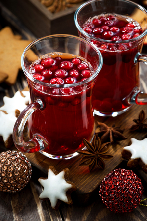 punch spice: Christmas drink hot cranberry tea and cookies, closeup Stock Photo