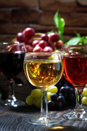 wine glasses on a dark wooden background, vertical, closeup