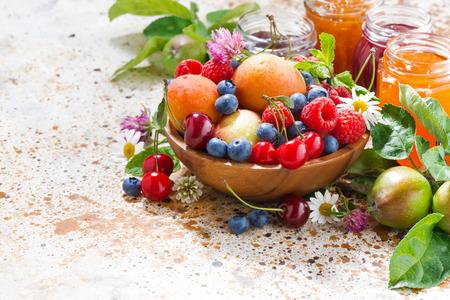 assortment of fresh seasonal fruits and berries, jams, horizontal