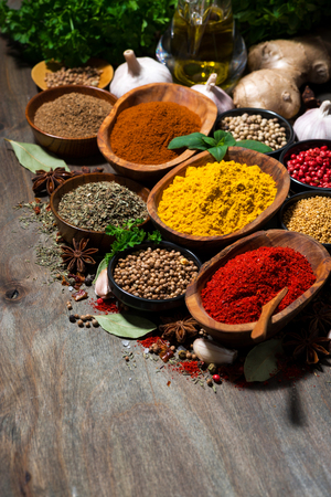 asian flavors: assortment of oriental spices on a wooden table, vertical, closeup Stock Photo