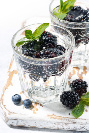fizz: carbonated drinks with fresh berries, vertical, closeup