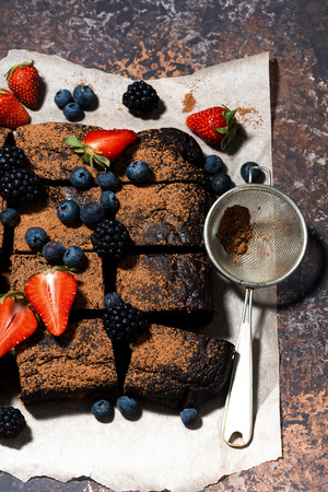 dessert - chocolate brownies with fresh berries, vertical top view Stock Photo
