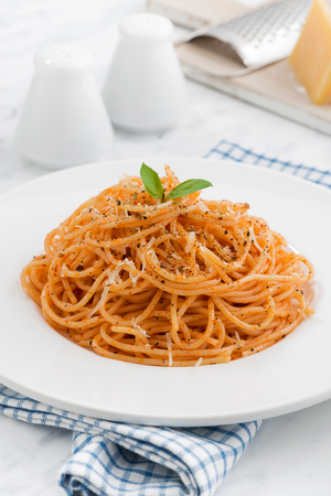 spice: plate of pasta with tomato sauce, vertical, closeup