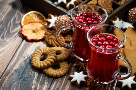 Christmas drink hot cranberry tea and cookies on dark background, top view, horizontal Stock Photo