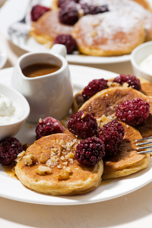 blini: sweet corn pancakes with berries for breakfast, closeup