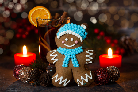 christmas composition with mulled wine and gingerbread man light bokeh closeup stock photo