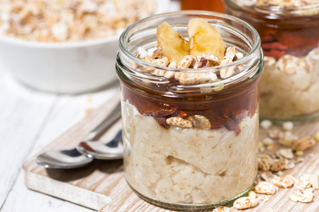 oat pudding with jam and bananas, closeup horizontal