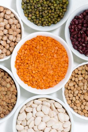assortment of legumes in bowls, closeup Stock Photo