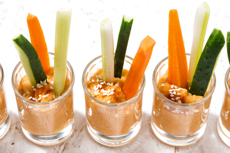 Pumpkin hummus and fresh vegetables, top view horizontal Stock Photo