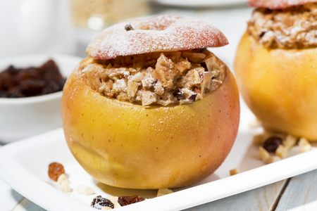 healthy breakfast. portioned oatmeal with raisins baked in apple, closeup horizontal Imagens