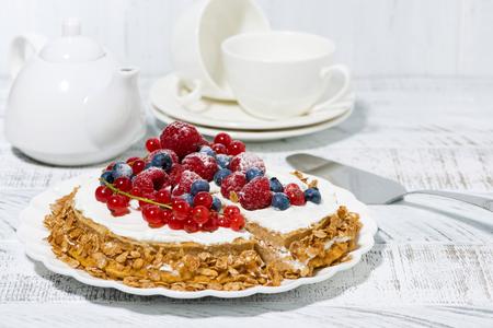 Healthy sweet oatmeal cake with yogurt and fresh berries, horizontal