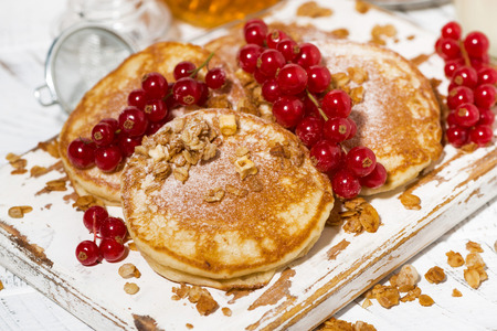 Felicious pancakes with berries and honey on a white wooden board, closeup horizontal 스톡 콘텐츠