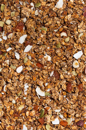 Homemade granola with nuts close-up, vertical top view Stock Photo