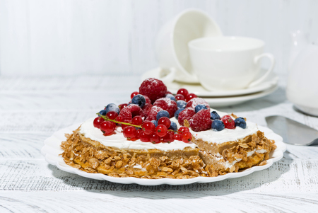 Healthy sweet oatmeal cake with yoghurt and fresh berries for dessert, horizontal