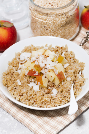 Healthy breakfast quinoa with apple and coconut, top view Stock Photo