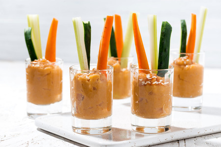 Healthy snack - pumpkin hummus and fresh vegetables, horizontal Stock Photo