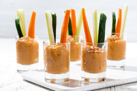 Healthy snack - pumpkin hummus and fresh vegetables, horizontal Reklamní fotografie