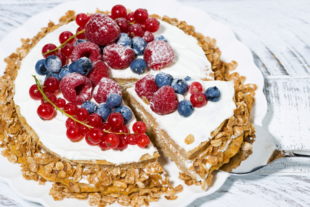 Healthy sweet oatmeal cake with yoghurt and fresh berries, closeup horizontal