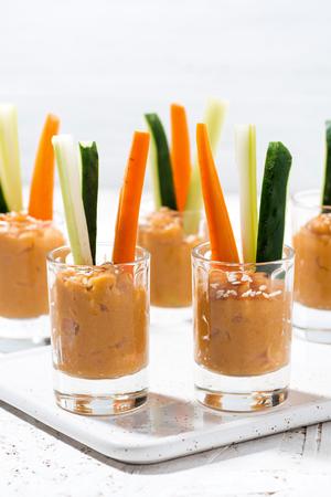 Healthy snack - pumpkin hummus and fresh vegetables, vertical closeup Reklamní fotografie