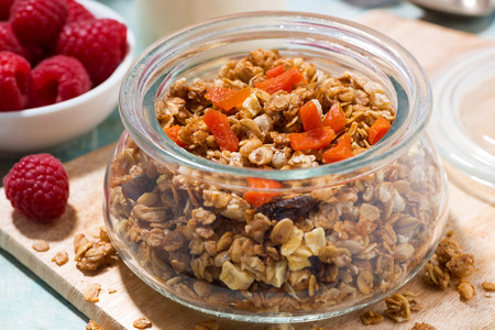 Homemade granola with dried apricots and nuts, closeup Reklamní fotografie