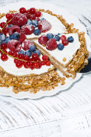 Healthy sweet oatmeal cake with yoghurt and fresh berries, vertical top view