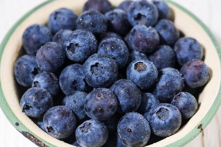 Fresh juicy blueberries in a bowl, closeup top view Reklamní fotografie