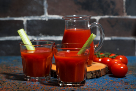 Fresh tomato juice in glass cups, horizontal