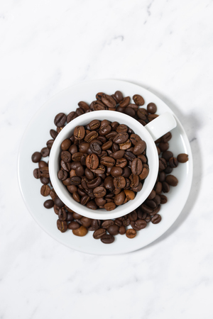 A cup of coffee beans, vertical top view Stock Photo