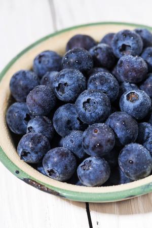 Fresh juicy blueberries in a bowl, closeup Reklamní fotografie