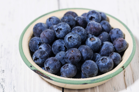 Fresh juicy blueberries in a bowl, closeup Stock Photo